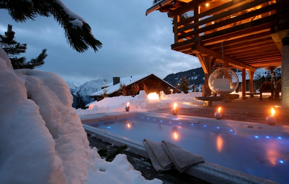 Picture snow, chairs, Jacuzzi, houses, mountains.