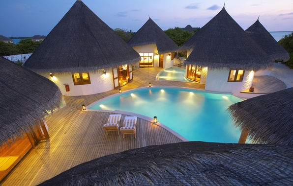 Picture sea, light, furniture, candles, pool, houses, sunbeds, island.