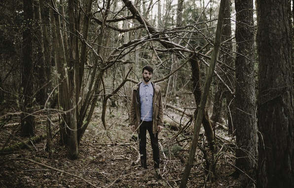 Picture forest, trees, man, branches, jacket, beard, direct gaze