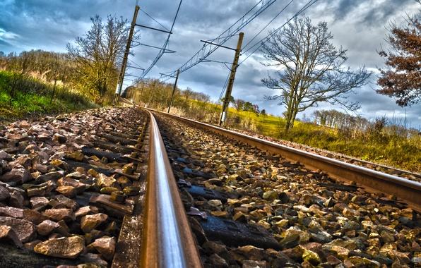 Picture trees, clouds, stones, rails, railroad