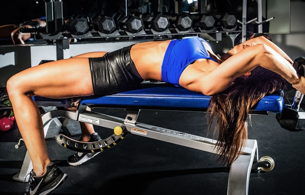 Picture woman, gym, dumbbells