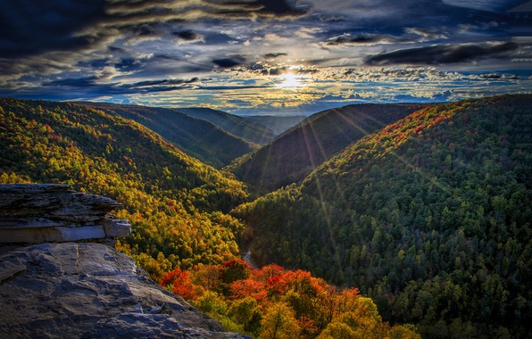 Picture forest, the sky, the sun, clouds, rays, sunset, mountains, river, stones, rocks