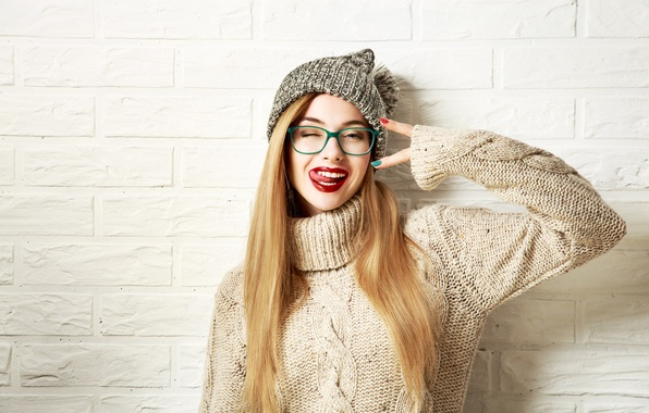 Picture girl, wall, hat, brick, makeup, glasses, hairstyle, blonde, gesture, grimace, sweater