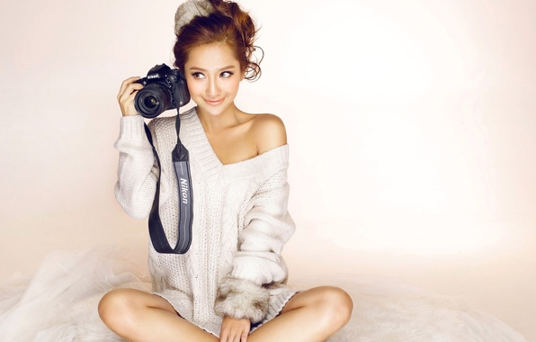 Picture girl, face, smile, the camera, Asian, jacket, sitting