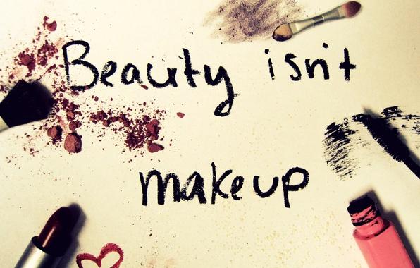 Picture the inscription, lipstick, mascara, brush, cosmetics