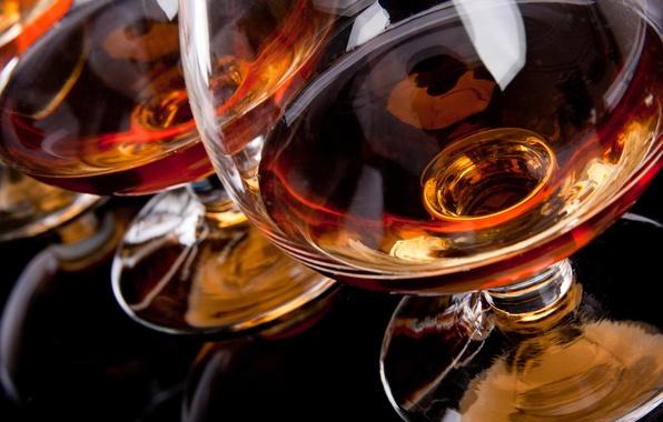 Picture reflection, glasses, black background, cognac