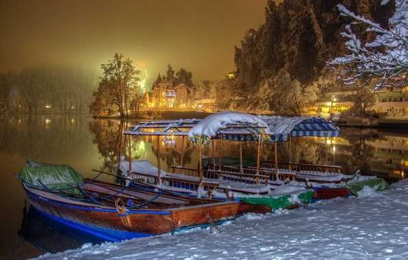 Picture winter, snow, trees, night, lights, lake, shore, home, boats, Slovenia, Bled