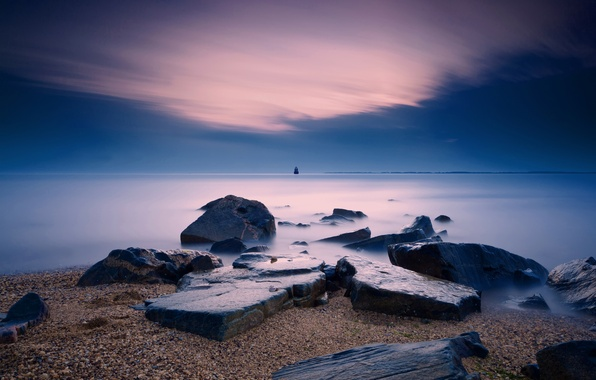 Picture sea, beach, stones, lighthouse, the evening