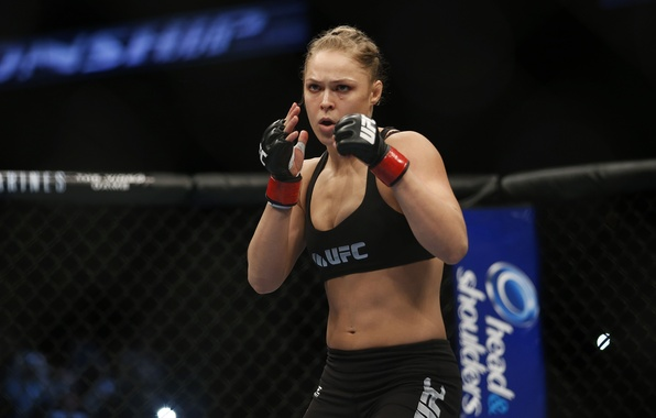 Picture the champion of UFC, Ronda Rousey, The Armbar Assassin, Rhonda Jean Rouse, Rowdy, MMA fighter