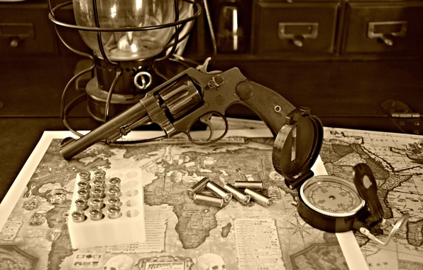Picture map, trunk, bullets, revolver, compass