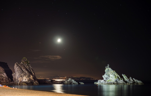 Picture sea, the sky, night, the city, lights, people, rocks, shore, The moon