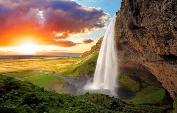 Picture the sky, the sun, clouds, bridge, rock, field, waterfall, space, river, Iceland, Seljalandsfoss