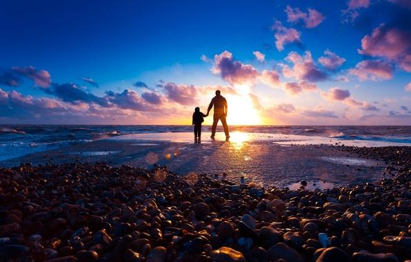 Picture sea, beach, the sun, rays, light, sunset, stones, mood, shore, boy, guy, silhouette