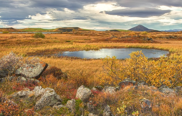 Picture autumn, the sky, grass, mountains, clouds, lake, stones, crater, the bushes