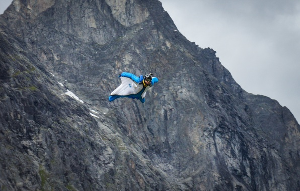 Picture flight, mountains, rocks, camera, parachute, container, helmet, pilot, extreme sports, wingsuit, base jumping, beyser