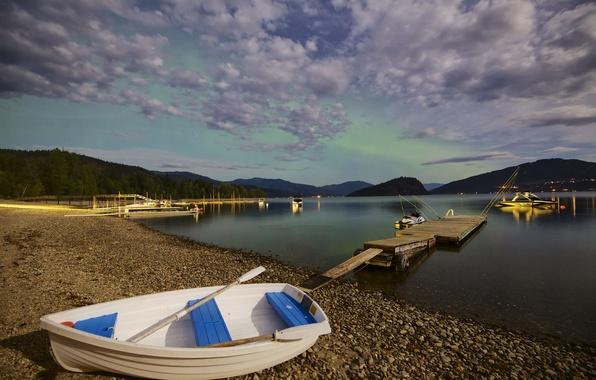 Picture the sky, mountains, lake, stones, shore, boat, the bridge