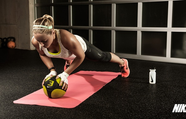 Picture woman, fitness, pushups, Russian dumbbell