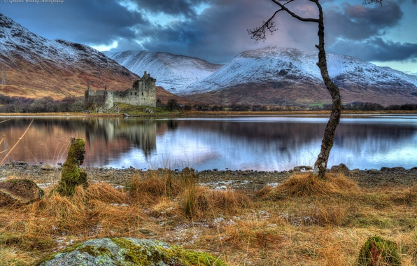 Picture grass, snow, mountains, clouds, lake, stones, castle, tree, overcast, shore, Scotland, the ruins, Kilchurn Castle