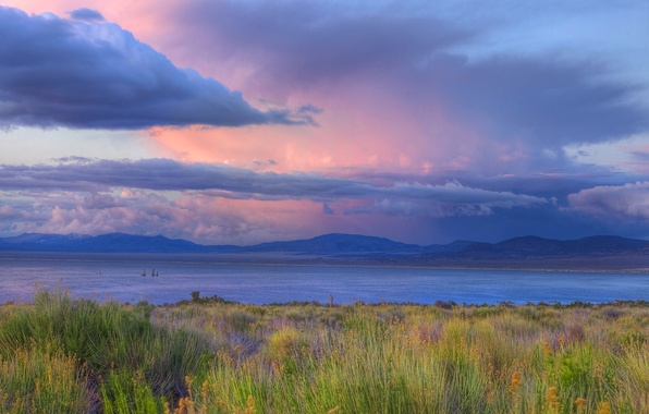 Picture the sky, grass, clouds, sunset, mountains, clouds, river, shore, horizon