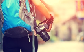 Picture the camera, photographer, backpack