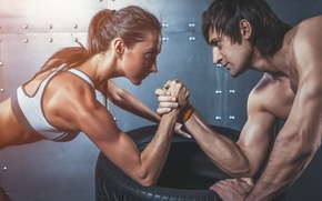 Picture woman, man, concentration, arm wrestling, physical state