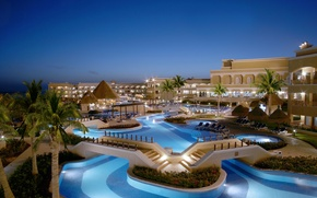 Picture pool, hotel, exterior, naght, palms.