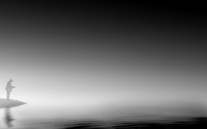 Picture fog, lake, fisherman