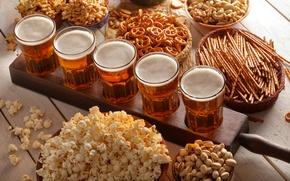 Picture foam, beer, glasses, drinks, popcorn, nuts, pistachios, cracker, straws, cashews