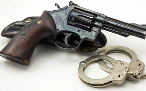 Picture revolver, handcuffs, holster, Smith & Wesson, .38 Special