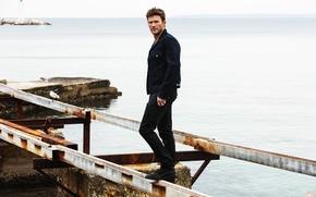 Picture sea, landscape, stones, shore, beams, jacket, photographer, actor, journal, pants, dzhinsovka, Scott Eastwood, Scott Eastwood, …