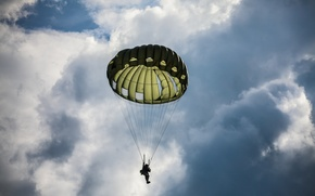 Picture the sky, clouds, people, parachute