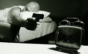 Picture gun, alarm clock, sleeping