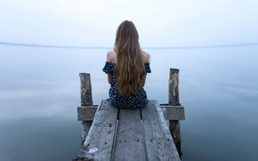 Picture loneliness, the water, long-haired girl