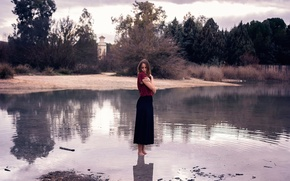Picture girl, in the water, barefoot
