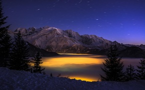Picture winter, forest, clouds, mountains, night, lights, height, gorge