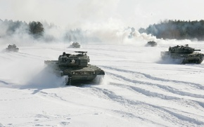 Picture the sky, snow, trees, smoke, the battle, tanks