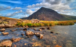 Picture the sky, clouds, river, stones, mountain