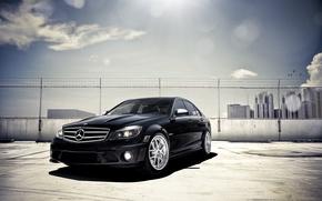 Picture black, Mercedes-Benz, Parking, black, Blik, skyscrapers, front, Mercedes Benz, C-Class, C 63