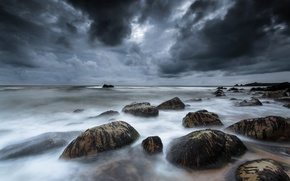 Picture clouds, stones, France, Celtic sea, gloomy sky