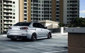 Picture the building, silver, Mitsubishi, Lancer, Evolution, skyscraper, Lancer, Mitsubishi, silvery, evolution