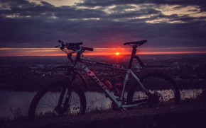 Picture the sky, the sun, clouds, rays, landscape, sunset, bike, the city, shore, sport, bike, bike, ...