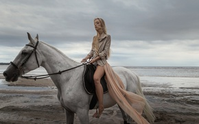 Picture girl, shore, horse, portrait, blonde, light, shirt, fashion, sky, sea, color, hair, look, with slightly …