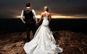 Picture sunset, the bride, the groom