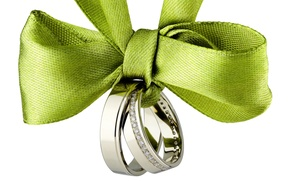 Picture ring, tape, bow, wedding rings