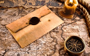 Picture map, compass, the envelope