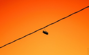 Picture sunset, shoes, wire