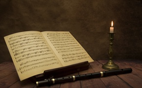 Picture notes, music, candles, flute