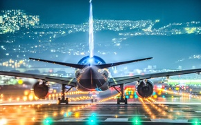 Picture lights, runway, the plane, the city