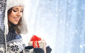 Picture winter, girl, snow, smile, hat, brunette, sweater, gloves, face, gift