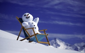 Picture the sun, snow, mountains, new year, snowman